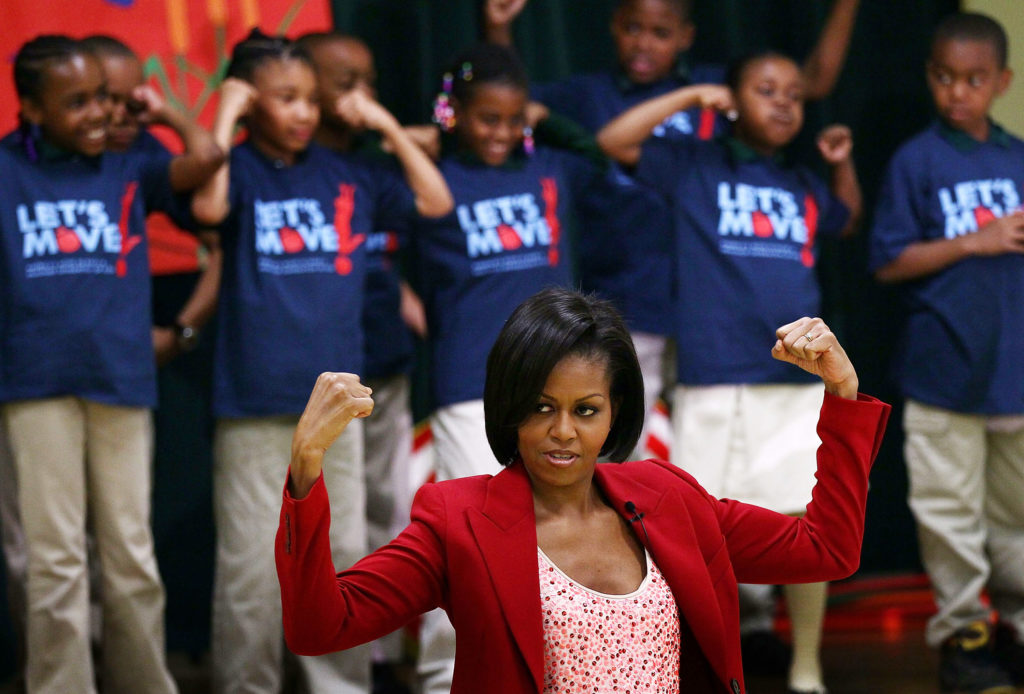 Michelle Obama leading the campaign, Eat Less, Move More. Fasting education could be beneficial versus just one single approach.  (Photo by Win McNamee/Getty Images)