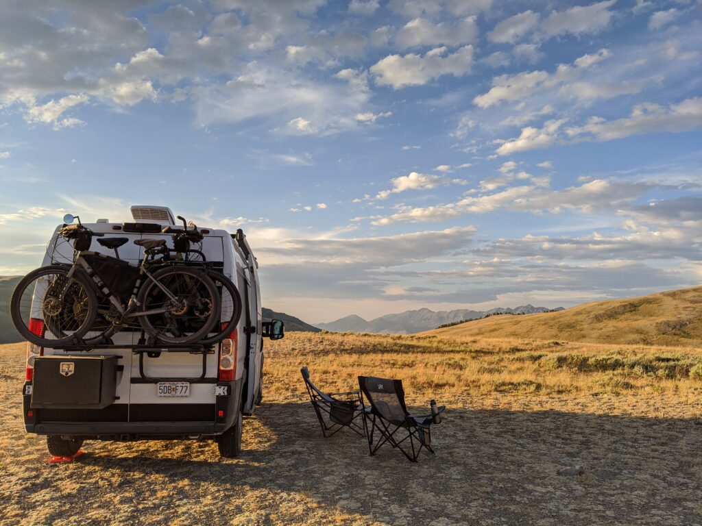 Rear view of the van with our camp chairs sitting outside for admiring the view.